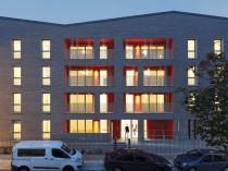 Trois immeubles aux loggias colorées donnent du ...