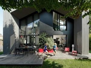 Une maison familiale à ossature bois qui joue à ...